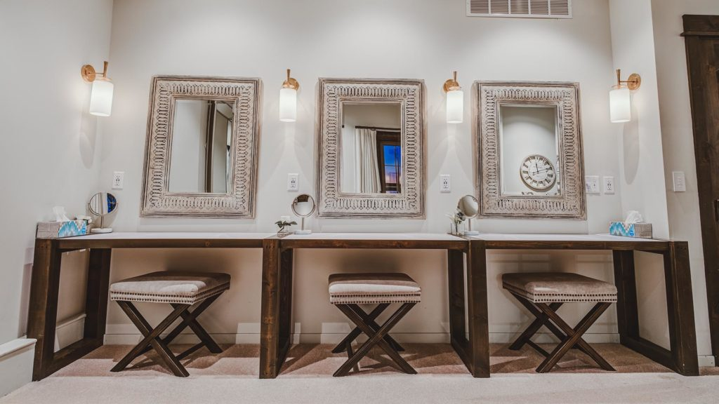 vanity station with mirrors and stools at Palace Event Center