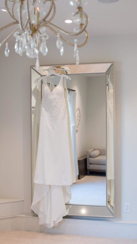 wedding dress displayed in bridal suite at Palace Event Center | photo by Get Kara'd Away