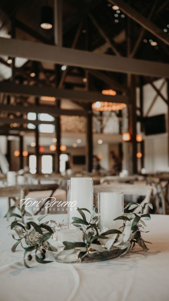 candle and greenery centerpieces at Palace Event Center | photo by Tori Bruno