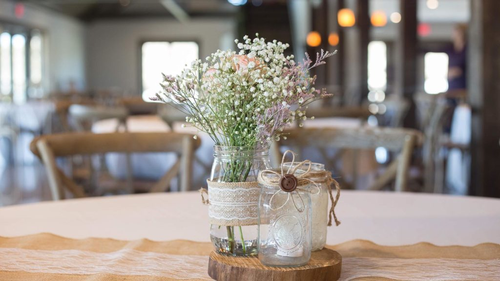 floral centerpiece with jars at Palace Event Center | photo by Get Kara'd Away