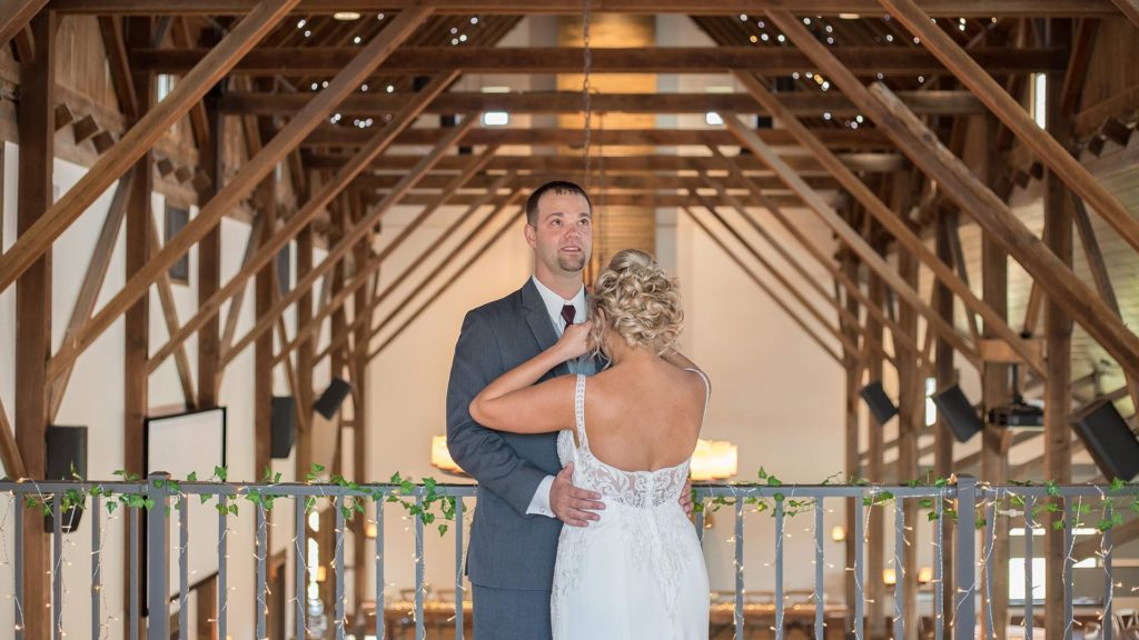 bride and groom first look in loft at Palace Event Center | photo by Get Kara'd Away