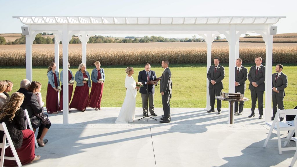 outdoor ceremony with couple at alter at Palace Event Center | photo by Get Kara'd Away