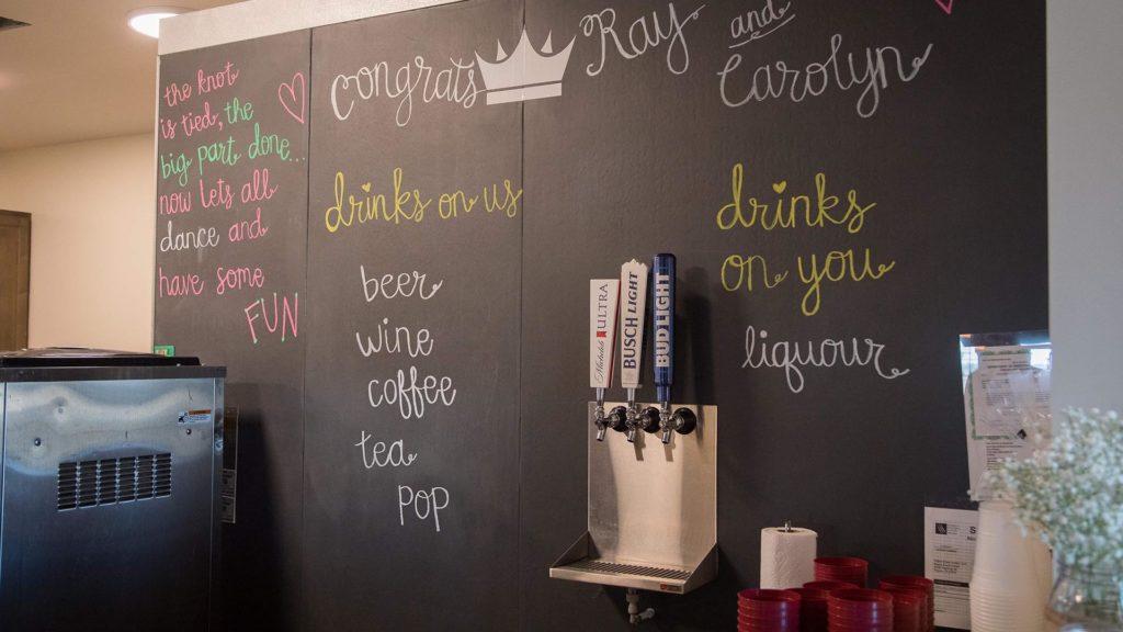 drink menu written on chalkboard wall at Palace Event Center | photo by Get Kara'd Away