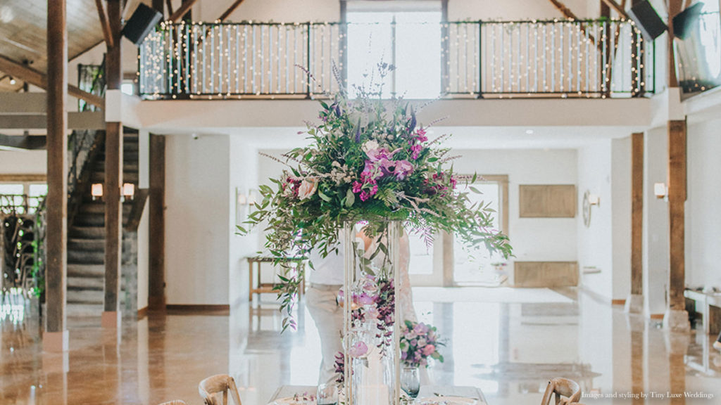beautiful floral arrangement in bright Palace Event Center interior | photo by Tiny Luxe Wedings