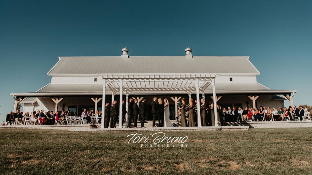 outdoor ceremony on sunny day at Palace Event Center | photo by Tori Bruno