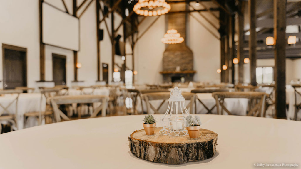 rustic table centerpiece with candle at Palace Event Center