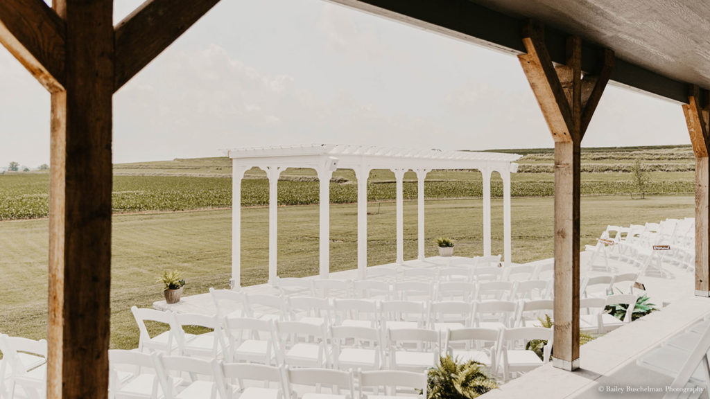 Outdoor wedding ceremony setup on patio at Palace Event Center