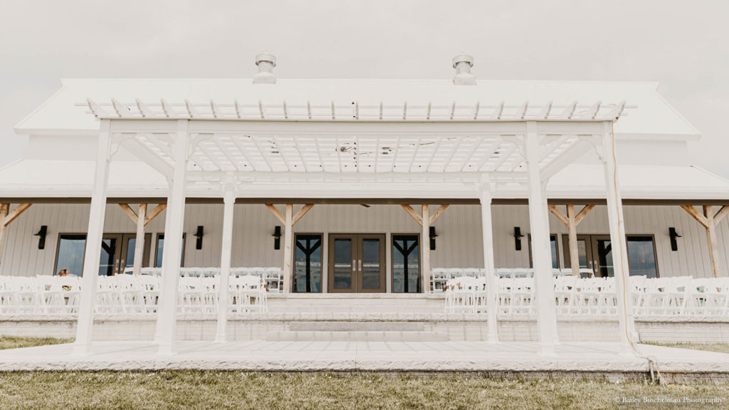 Exterior view of outdoor wedding ceremony setup at Palace Event Center
